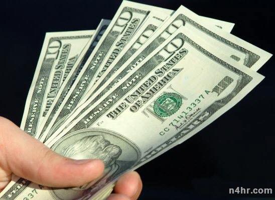 صور تنظيف الدولار من اللون الاسود الذي يغطيه